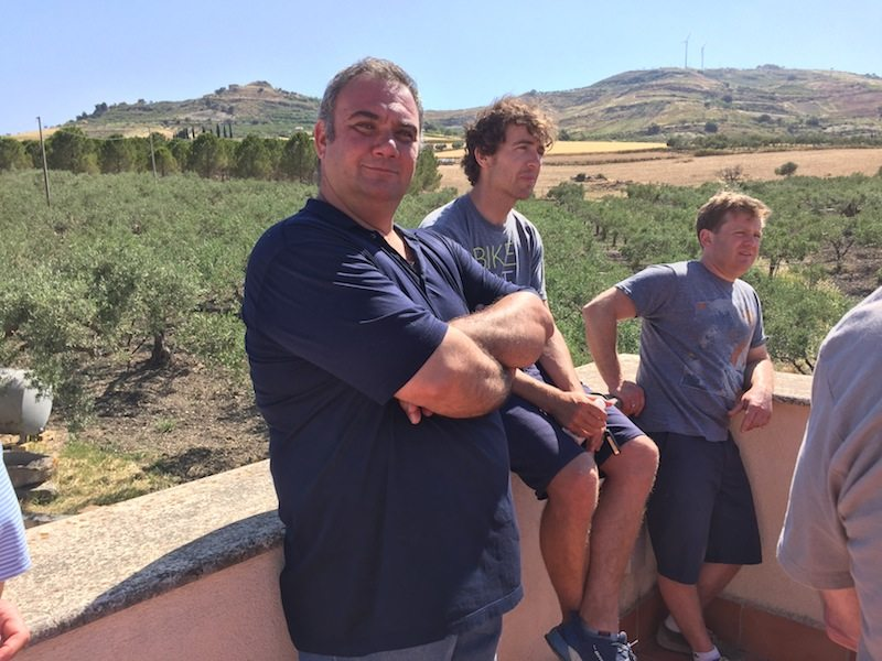 Mr Taibi proudly looking over his olive trees with our guide Tom and Chef Josh